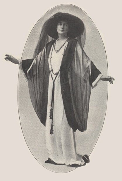 Roxane Barton as Honoria Lane in costume with arms stretched out to her sides.