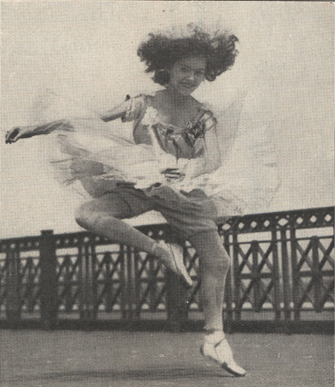 Female ballet dancer in mid-air.