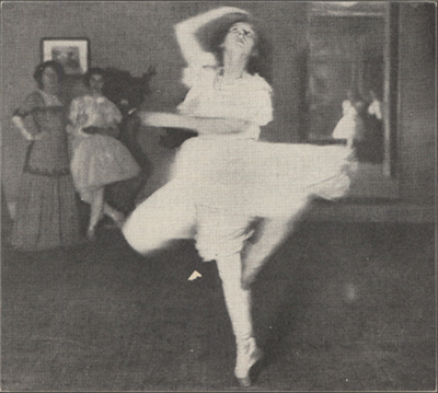 Female dancer spinning on one toe with toe of other leg pointed toward the calf of the leg she is spinning on.