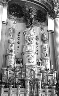 "Image of The main altar of Notre Dame des Victoires Church. Although this altar was installed in 1878, Cather places it in the church in the 17th century and has Cecile imagine ""that the Kingdom of Heaven looked exactly like this from the outside."""