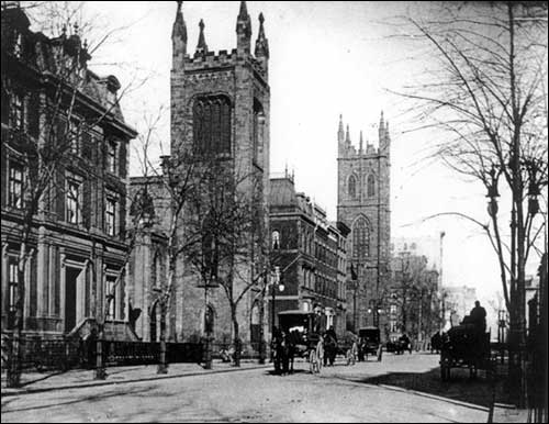 Image of Fifth Avenue looking north from E. 10th Street, Church of the Ascension foreground, First Presbyterian Church further up (about 1900).